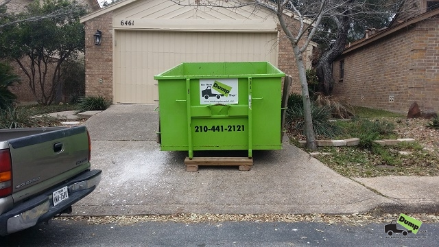 Dumpster with driveway protection